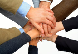 Photograph of multiple hands holding | NLP World.