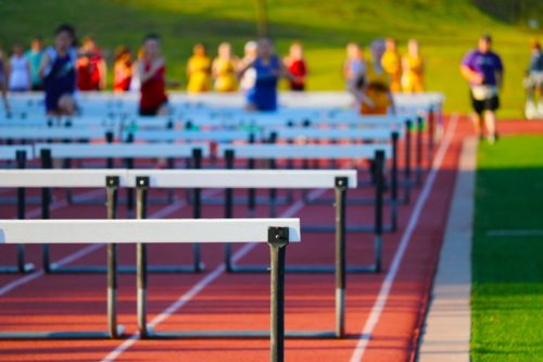 hurdles on a running track