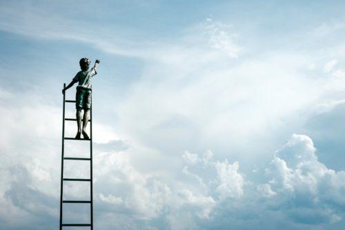 Blue cloudy sky with boy climbing ladder